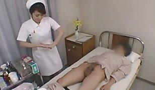 Asian nurse takes advantage of patient