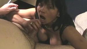 Kinky Asian MILF masturbates and sucks a white cock
